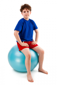 Boy on exercise ball